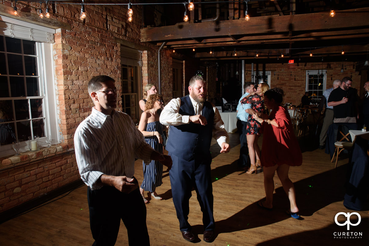 Groom dancing at the reception.