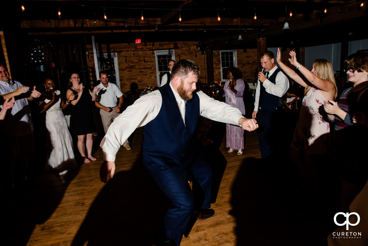 Groom dancing.