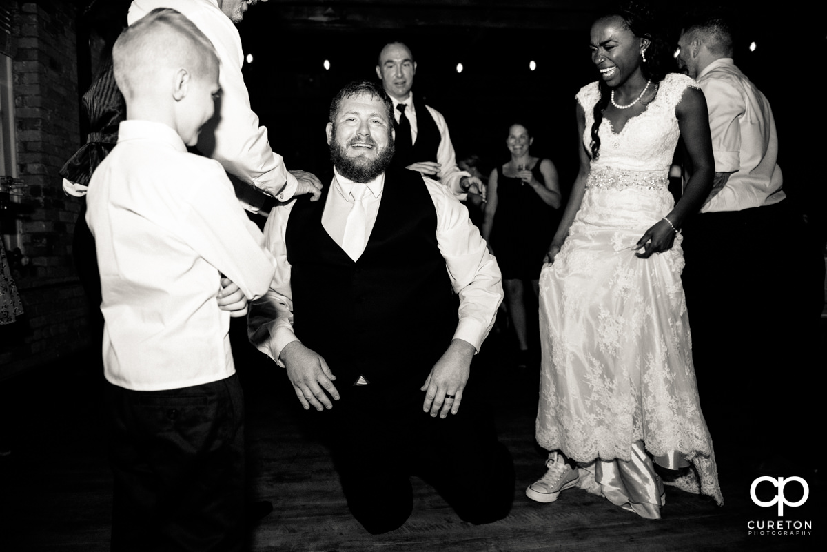 Groom on the floor dancing.