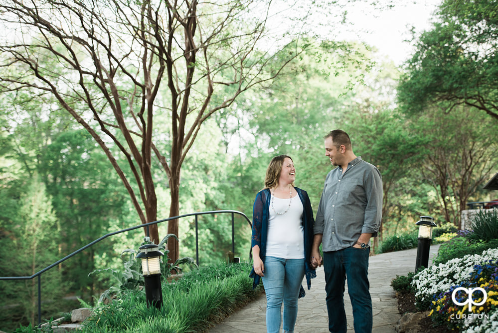 Future bride and groom having an engagement session in downtown Greenville SC at Falls Park.