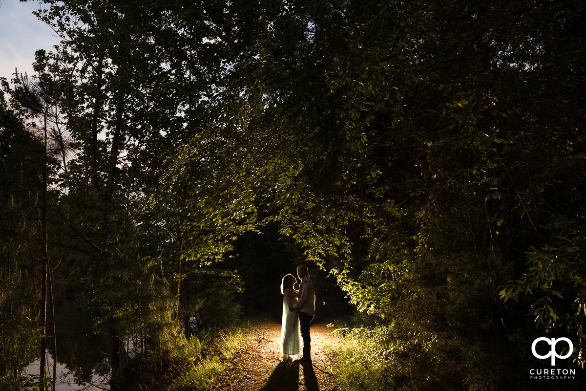 Bride and groom dancing in the woods during a family farm engagement session in Gray Court,SC.