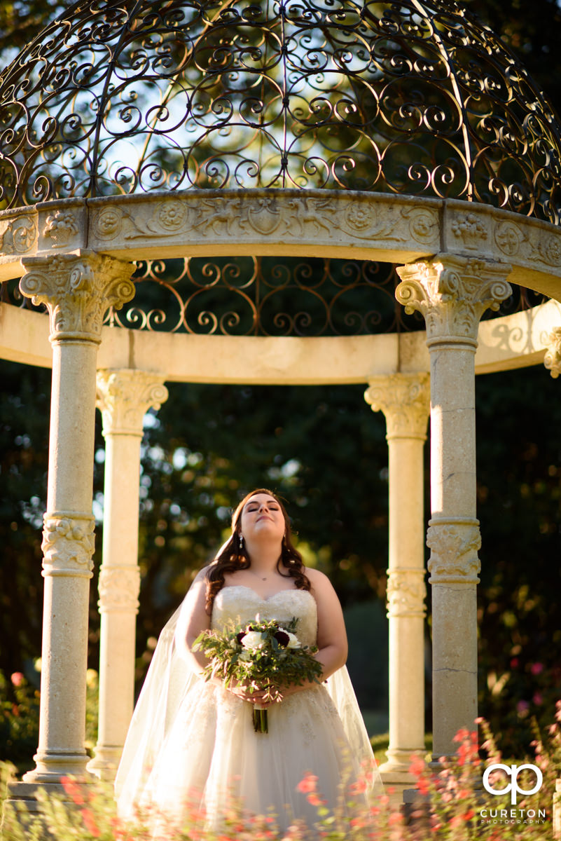 Bride glowing in sunlight during her bridal session at Furman University.