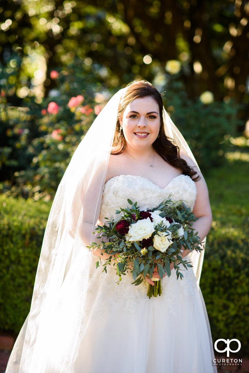 Bride posing in the rose garden at Furman University.