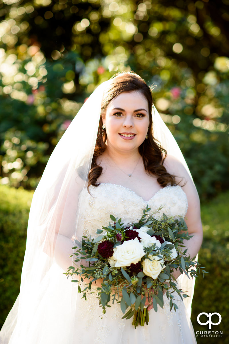 Beautiful bride in the rose garden at Furman University.