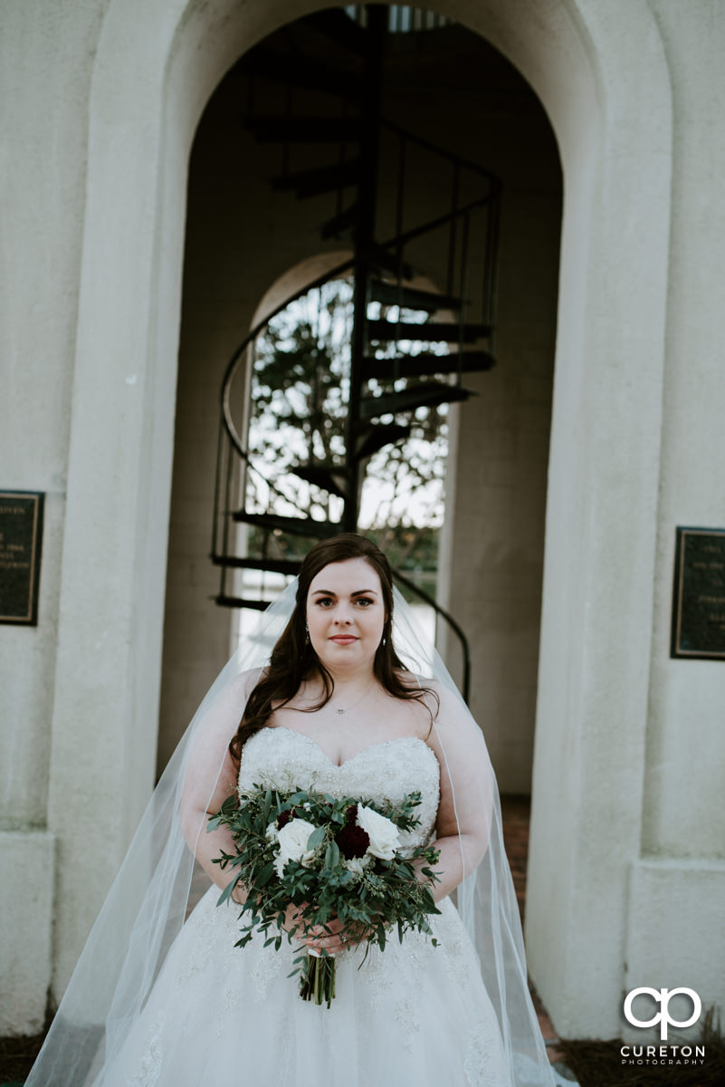 Bride in front of the bell tower at Furman University.