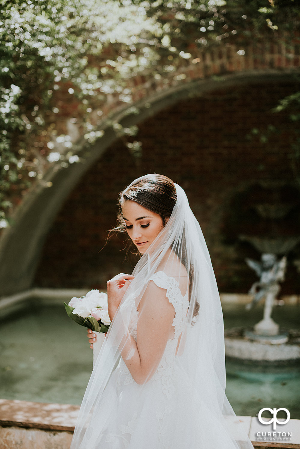 Stunning high fashion bridal at the rose garden on the Furman University campus.