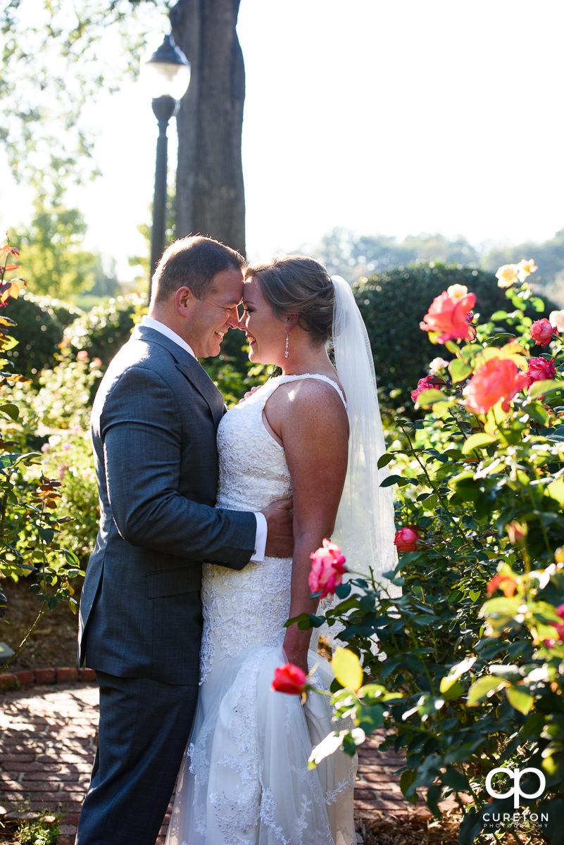 Bride and groom in the rose garden.