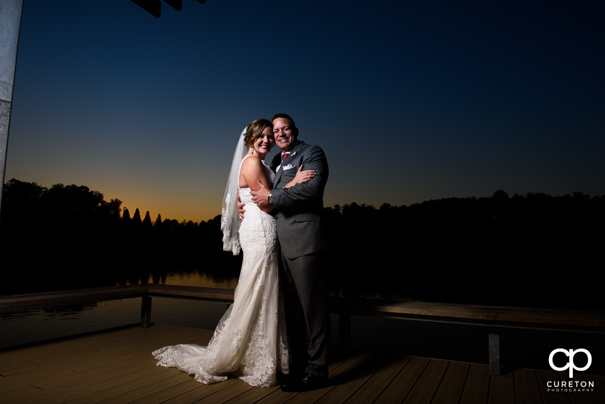 Bride and groom at sunset after their wedding at Furman wedding.