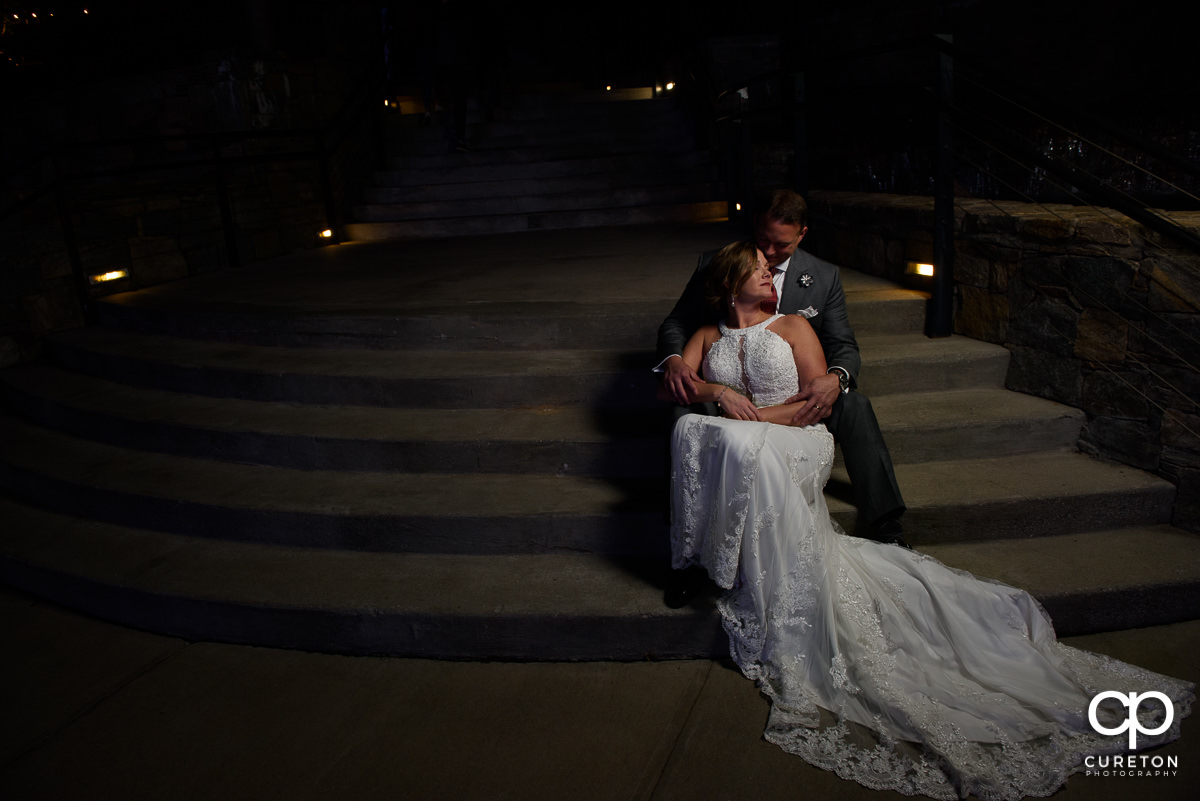 Bride and groom on the steps by the Lazy Goat in downtown Greenville,SC.