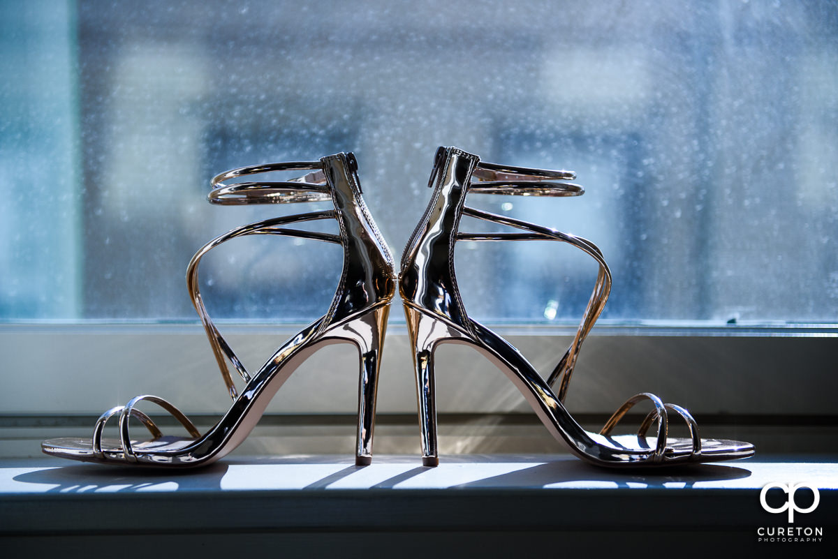 Bridal shoes on a window sill.