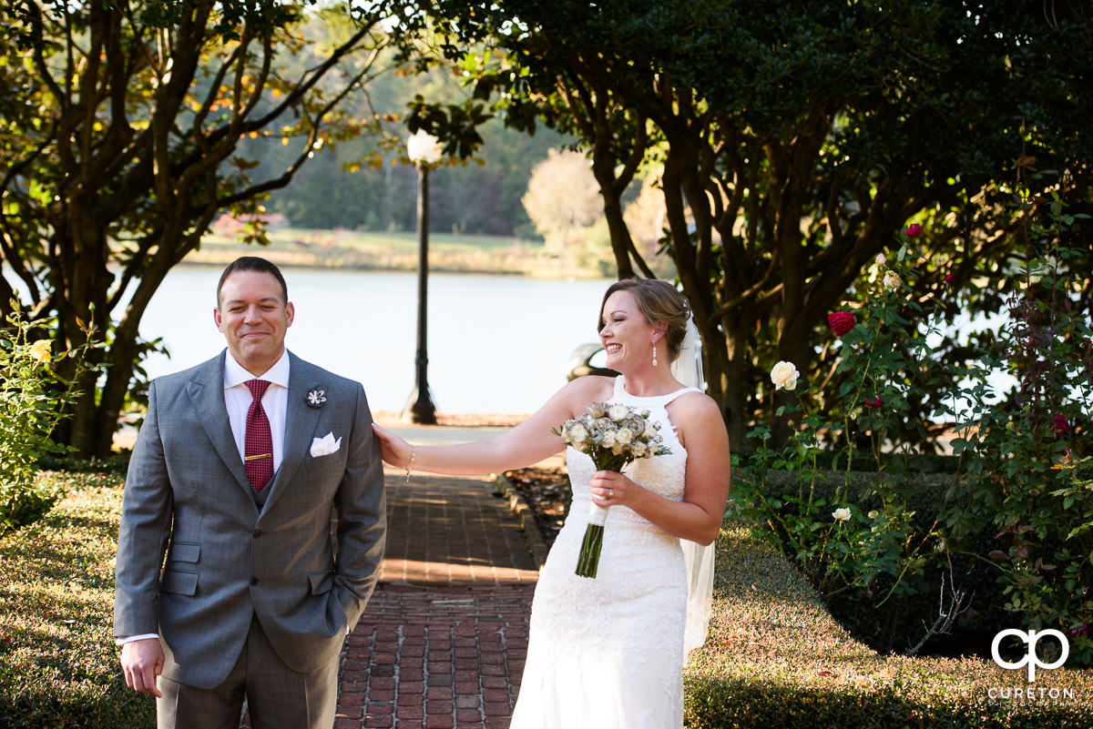 Bride sneaks up on her groom during a first look before the ceremony.
