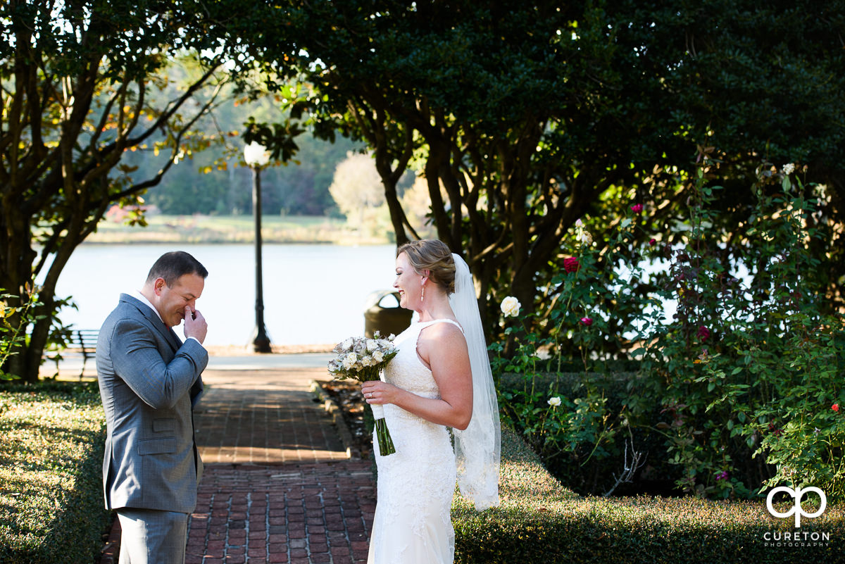 Groom getting emotional when he sees his bride during the first look.