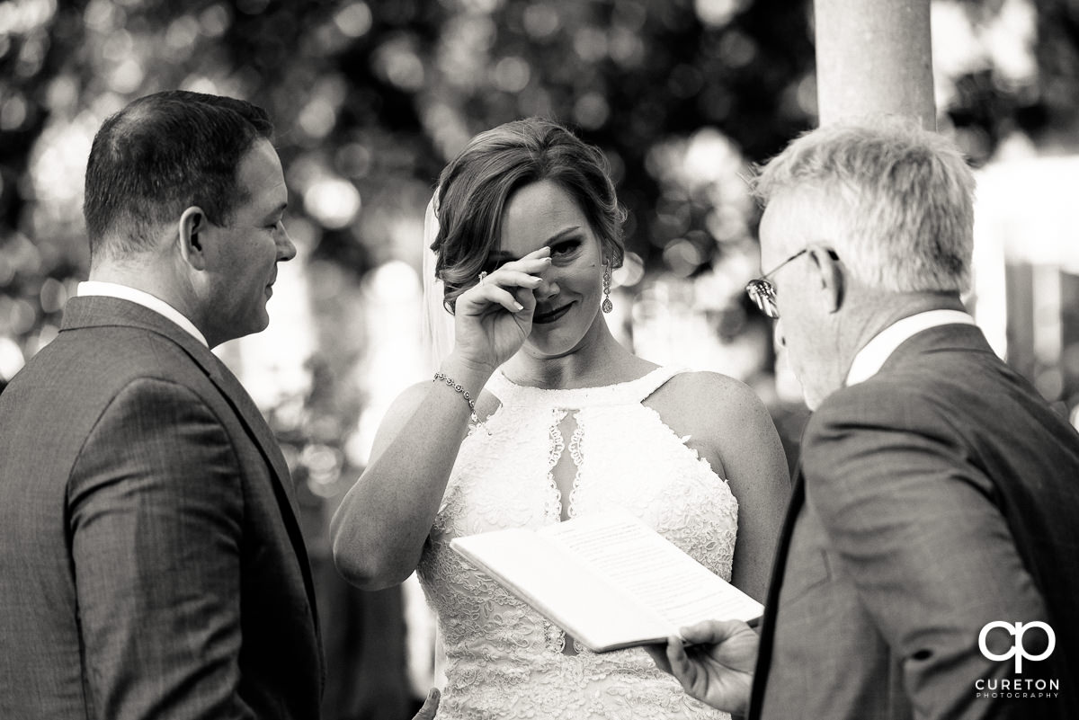 Bride crying during her wedding ceremony in the rose garden at Furman.