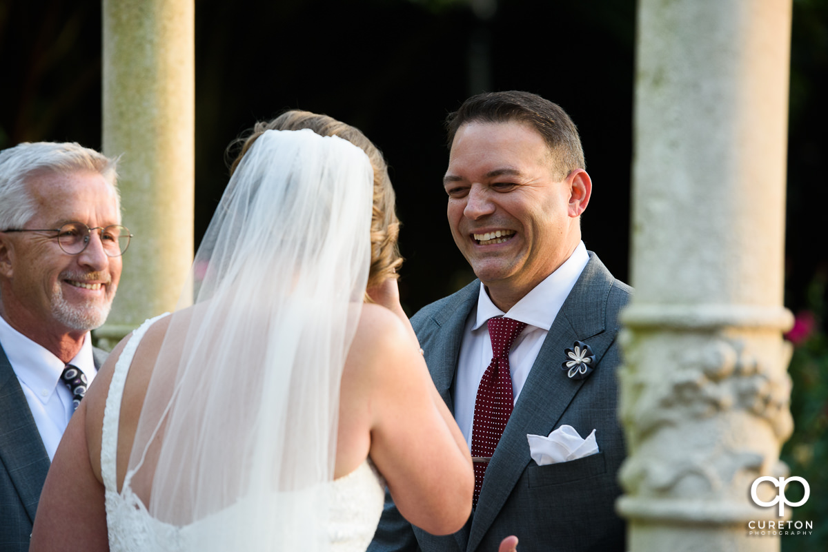 Groom laughing during the ceremony.