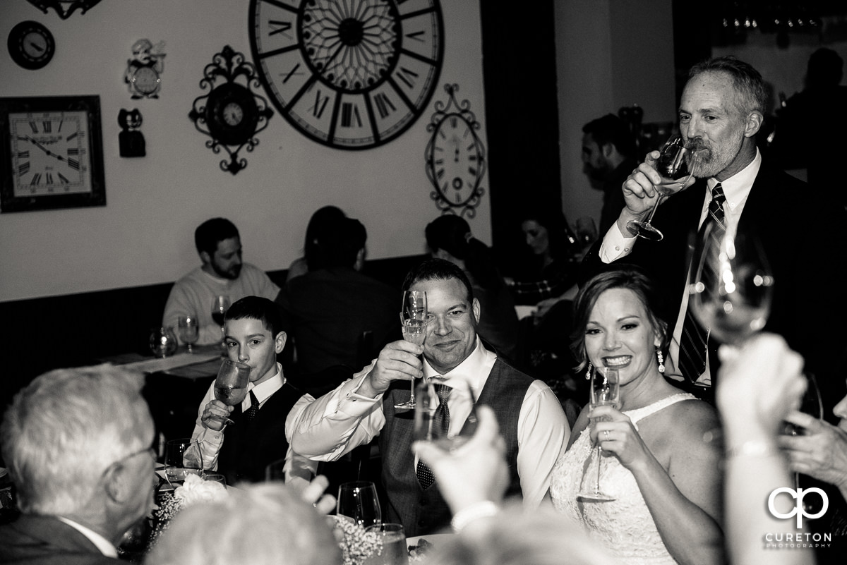 Bride and Groom toasting at dinner.