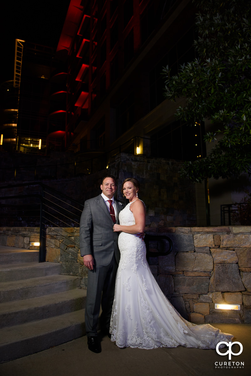 Newlywed couple outside The Lazy Goat in downtown Greenville,SC.