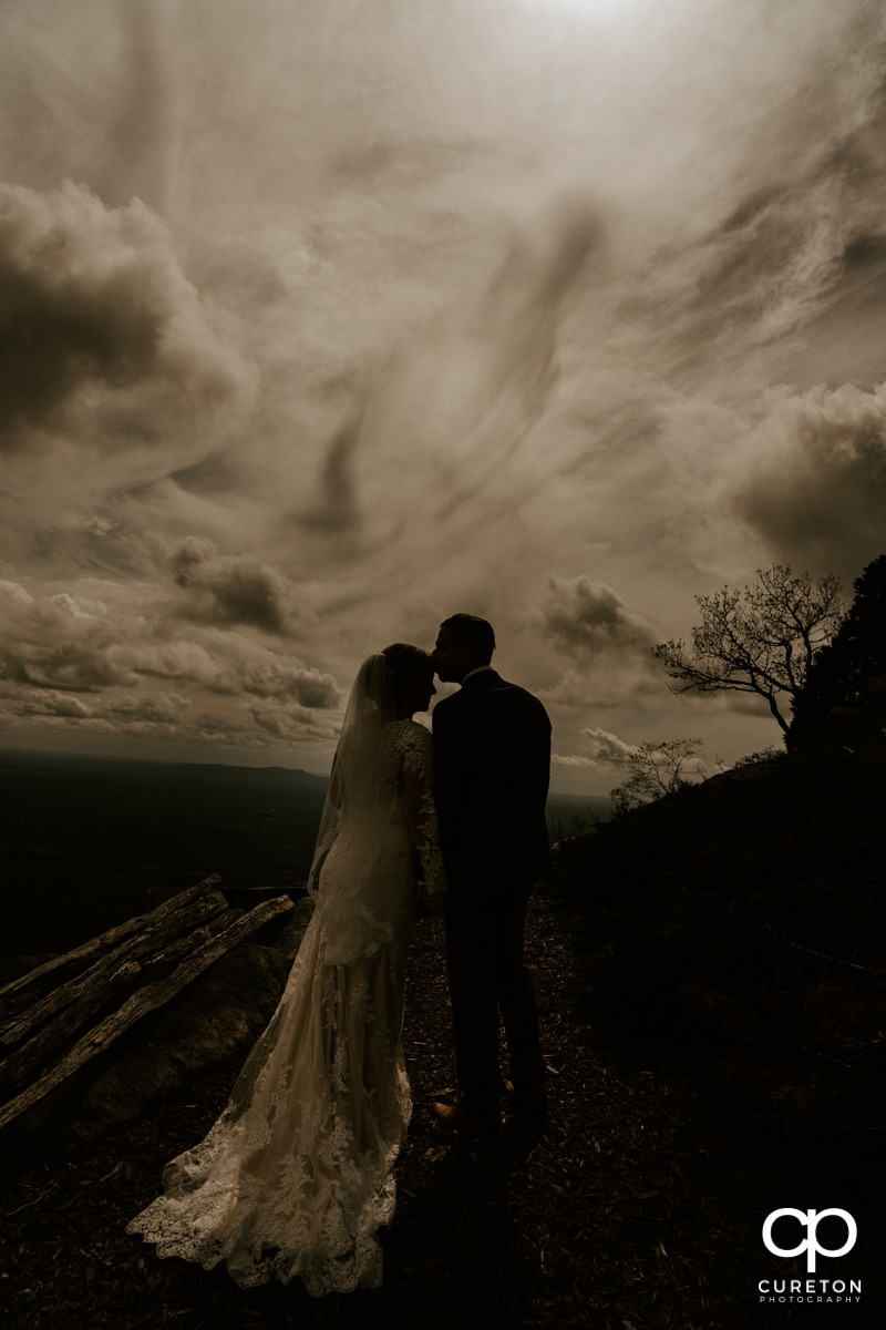 Silhouette of a bride and groom after their wedding at Glassy Chapel.