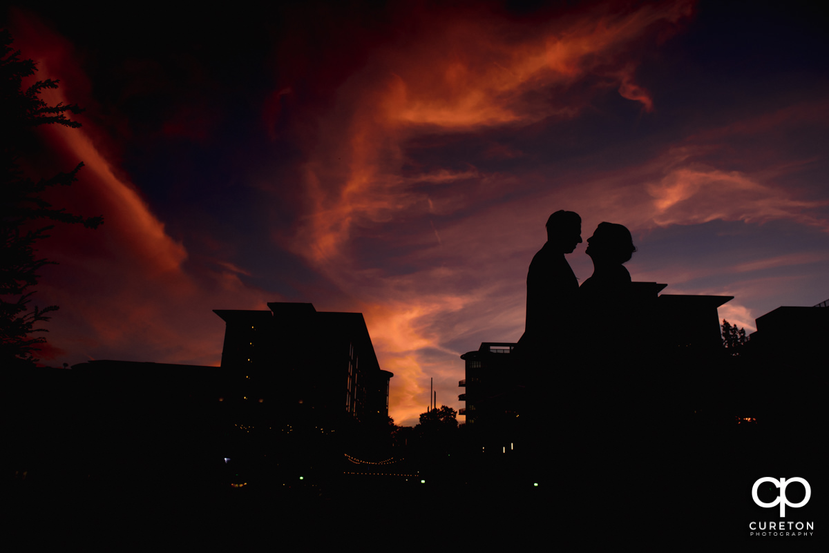 Silhouette of a bride and groom at sunset in downtown Greenville,SC.