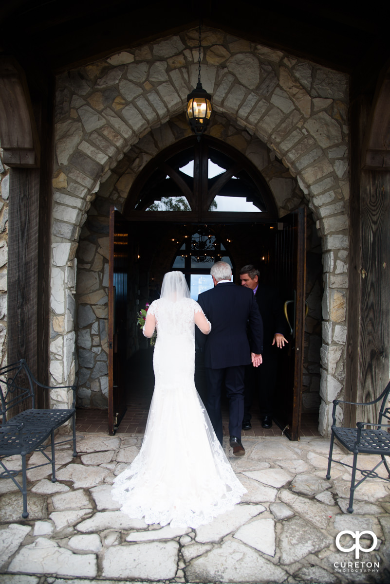 Bride and her dad walking into the chapel.
