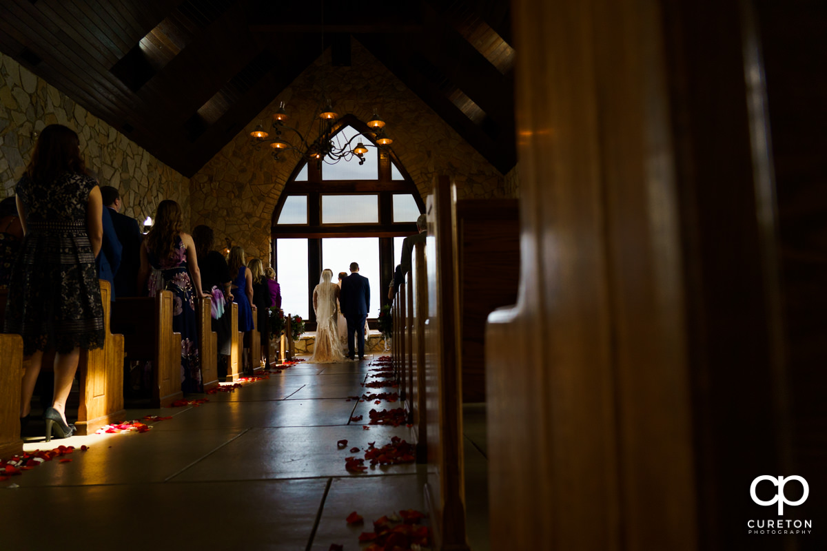 Bride and groom at the altar during a Ukrainian Catholic wedding ceremony at Glassy Chapel in Landrum,SC.