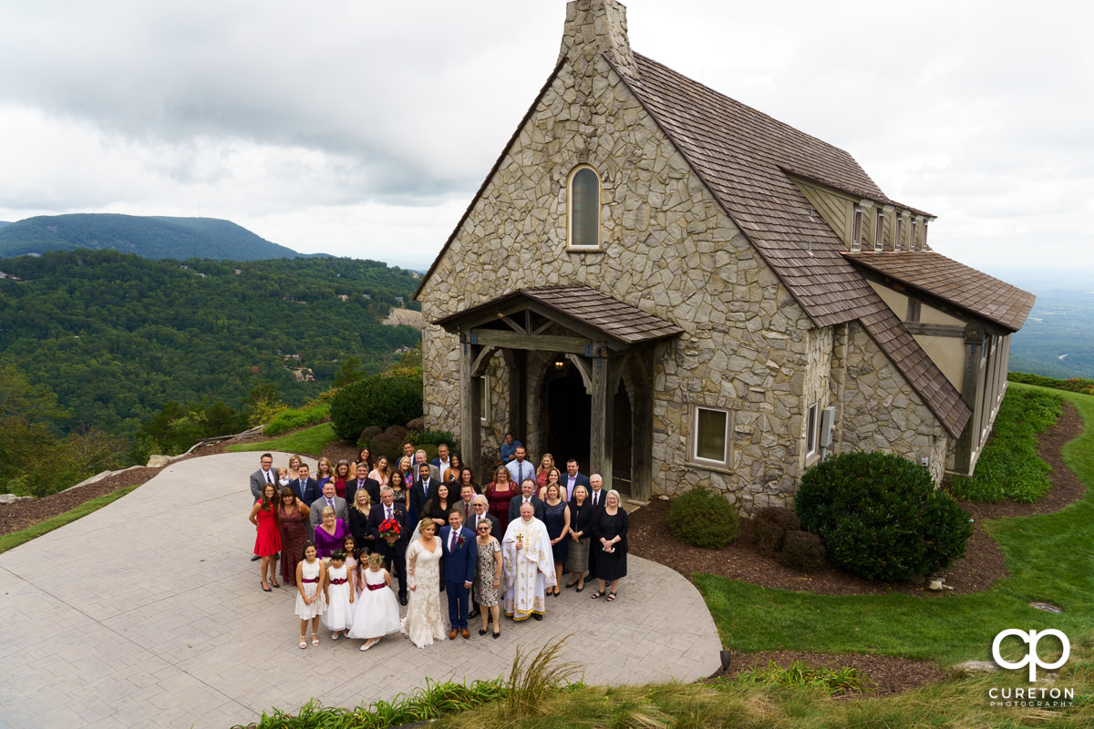 Wedding guests standing outside of the chapel.