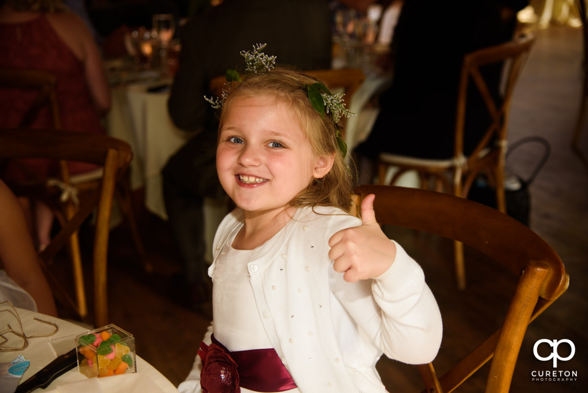 Flower girl giving the thumbs up.