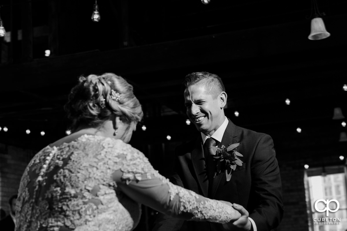 Groom laughing during their first dance.