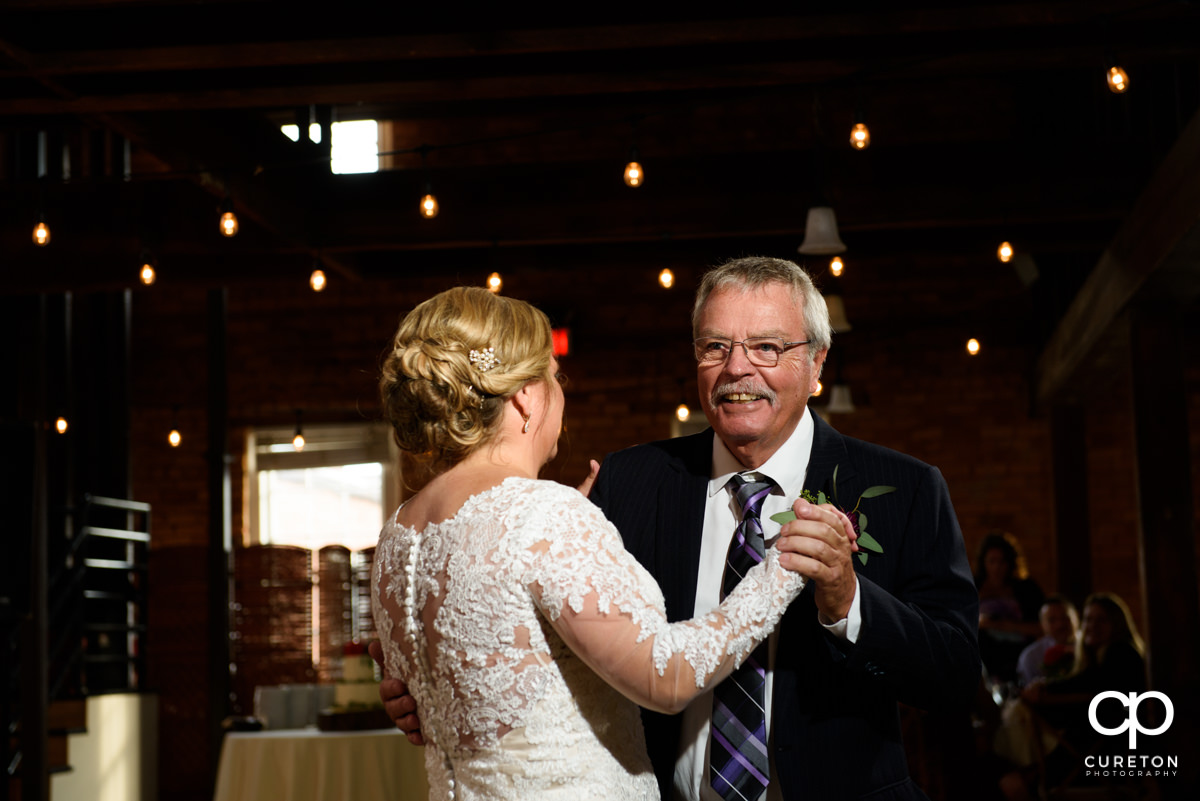 Bride sharing a dance with her father at their Larkin's Cabaret Room wedding reception in downtown Greenville,SC.