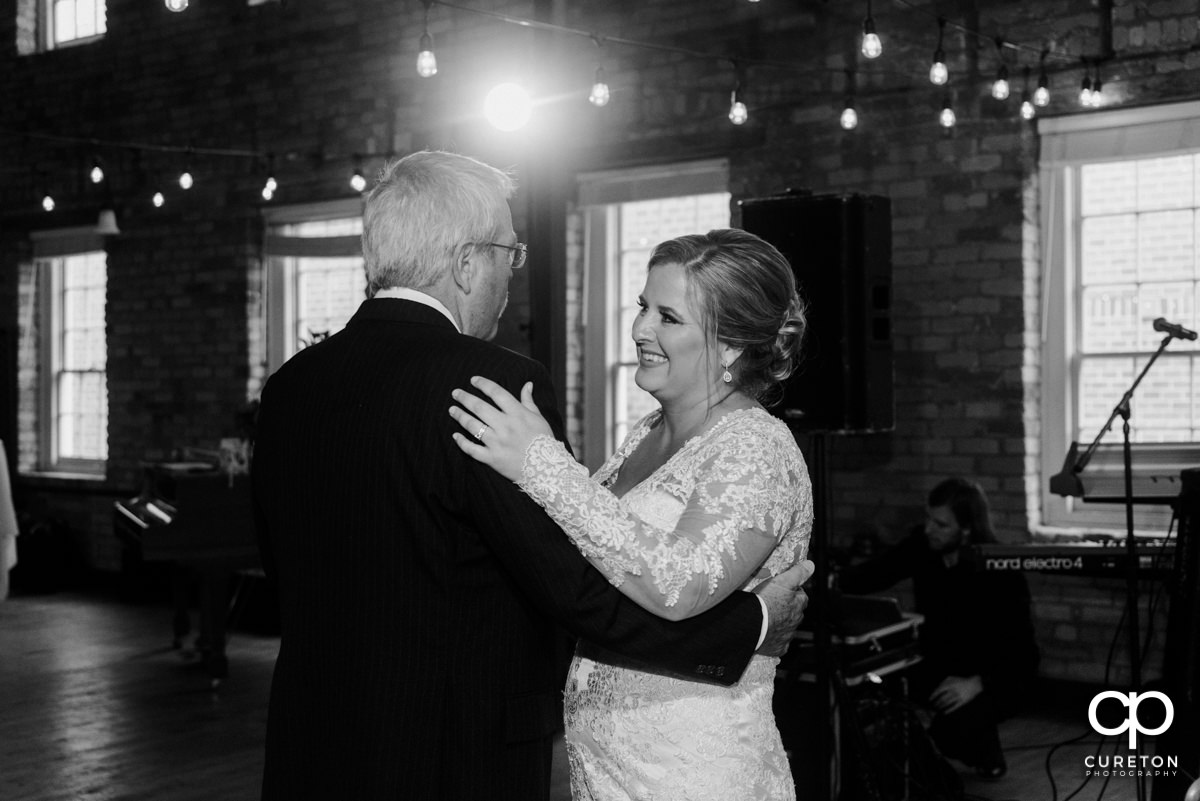 Bride sharing a dance with her father at the reception.