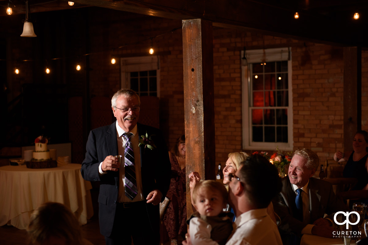 Bride's father giving a toast at the reception.