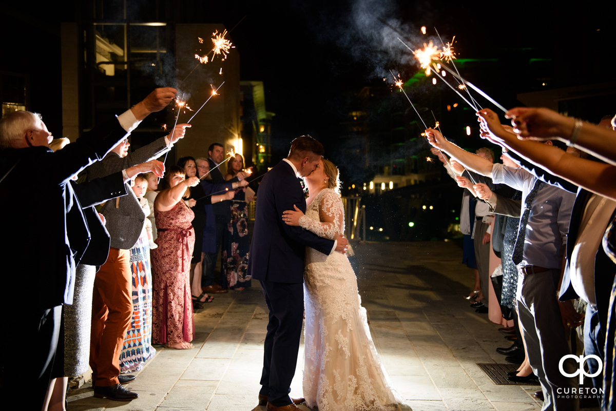 Bride and groom making a grand sparkler exit from their wedding reception at Larkin's Cabaret Room in downtown Greenville,SC.