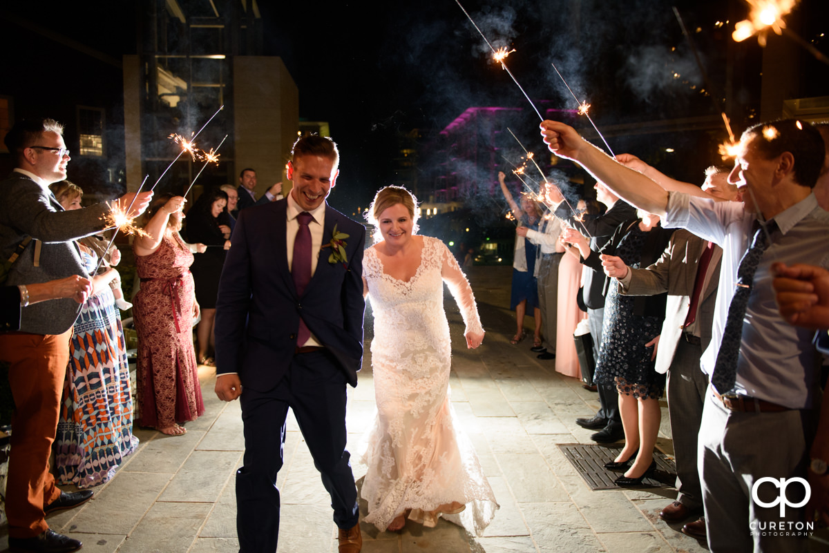 Bride and groom making a grand sparkler exit from their wedding reception at Larkin's Cabaret Room.
