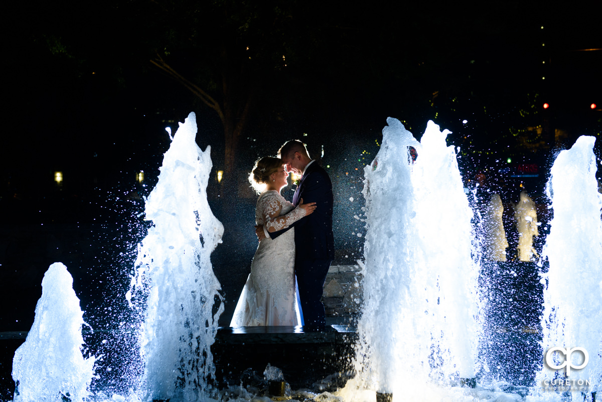 Bride and groom dancing in the fountains at their Larkin's Cabaret Room wedding reception in downtown Greenville,SC.