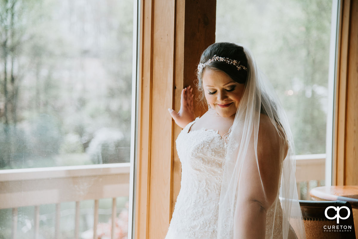 Bride looking at her veil.