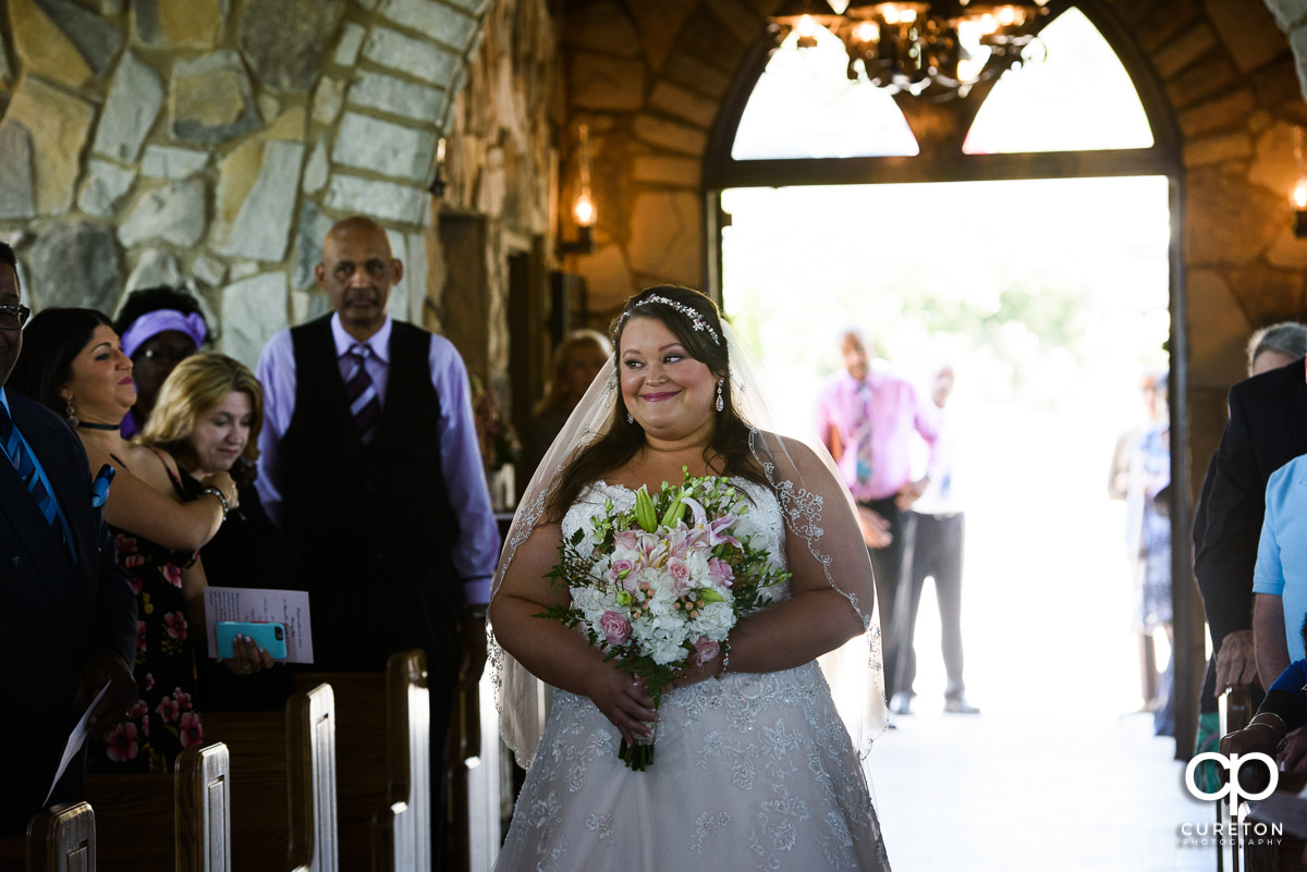 Bride walking down the aisle at Cliffs Glassy Chapel.
