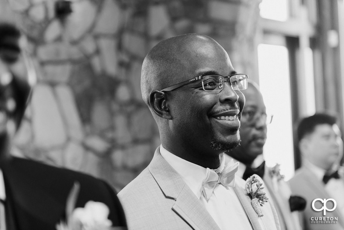 Groom's reaction seeing his bride walking down the aisle for the first time at Glassy Chapel.