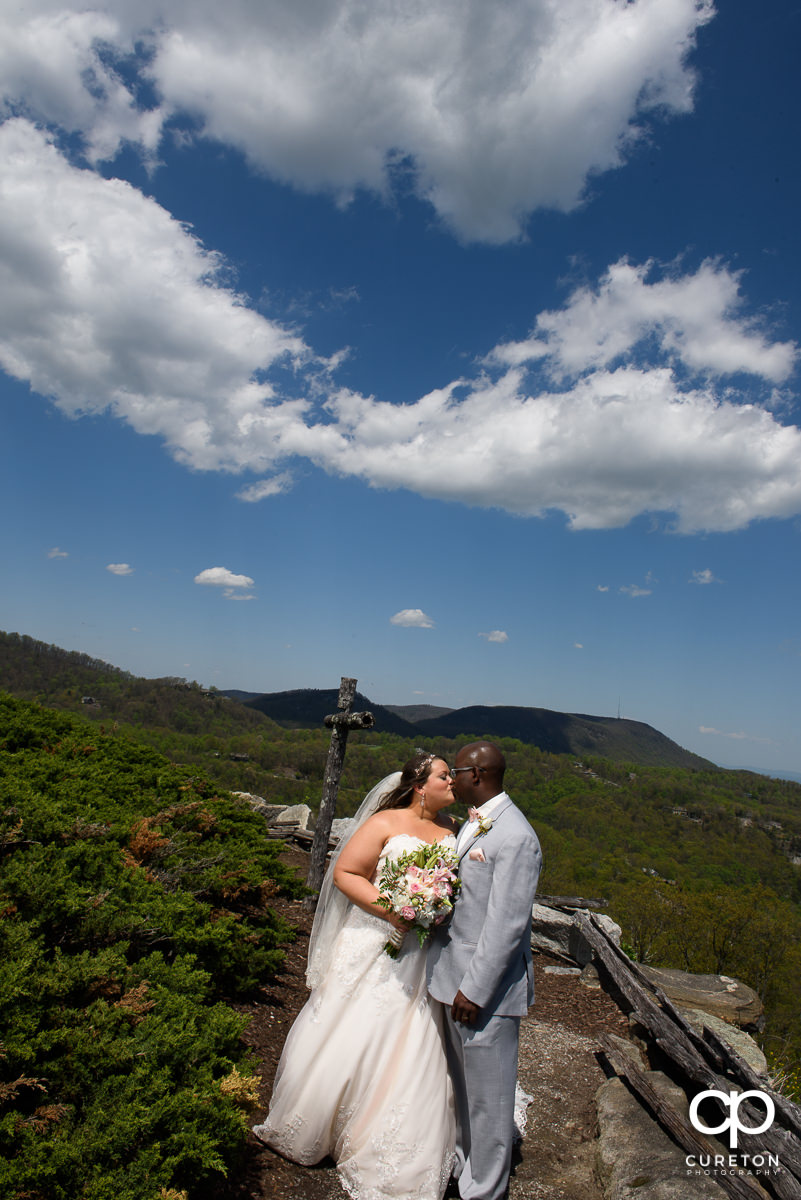 Bride and groom kissing at the Glassy Mountain overlook.