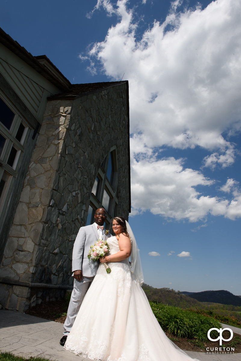 Bride and groom outside at the mountain top wedding chapel.