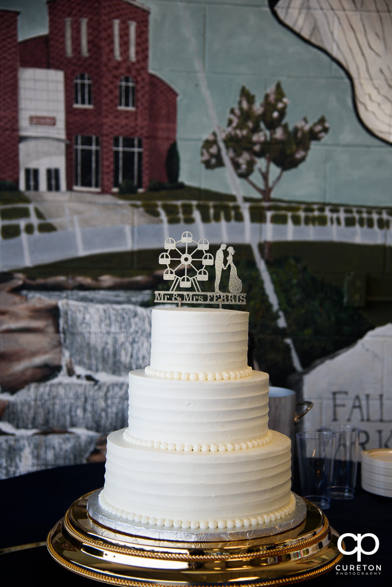 Wedding cake with custom ferris wheel topper.