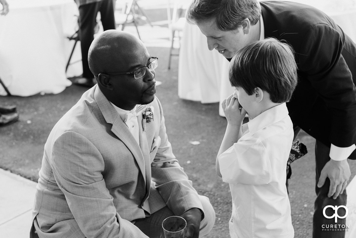 Groom talking to the ring bearer.