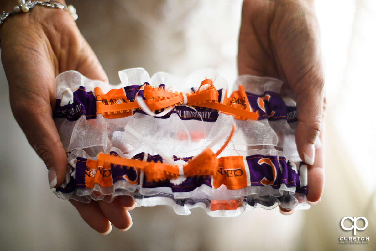 Bride holding her Clemson garters before the wedding.