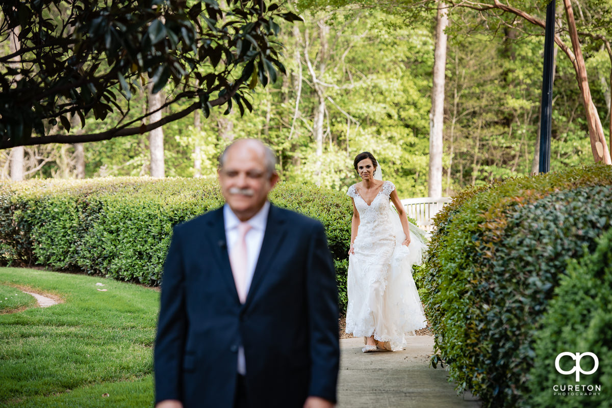 Bride having a first look with her dad.