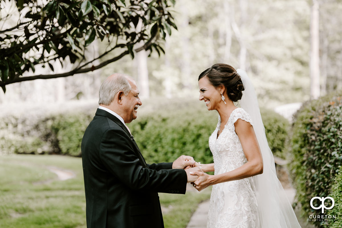Bride holding hand with her dad.
