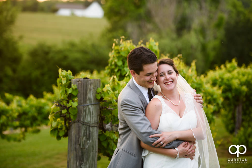 Bride and groom in the vineyard at Greenbrier Farms.