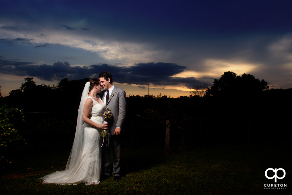 Married couple at sunset.