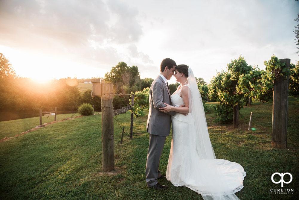 Bride and groom at golden hour.