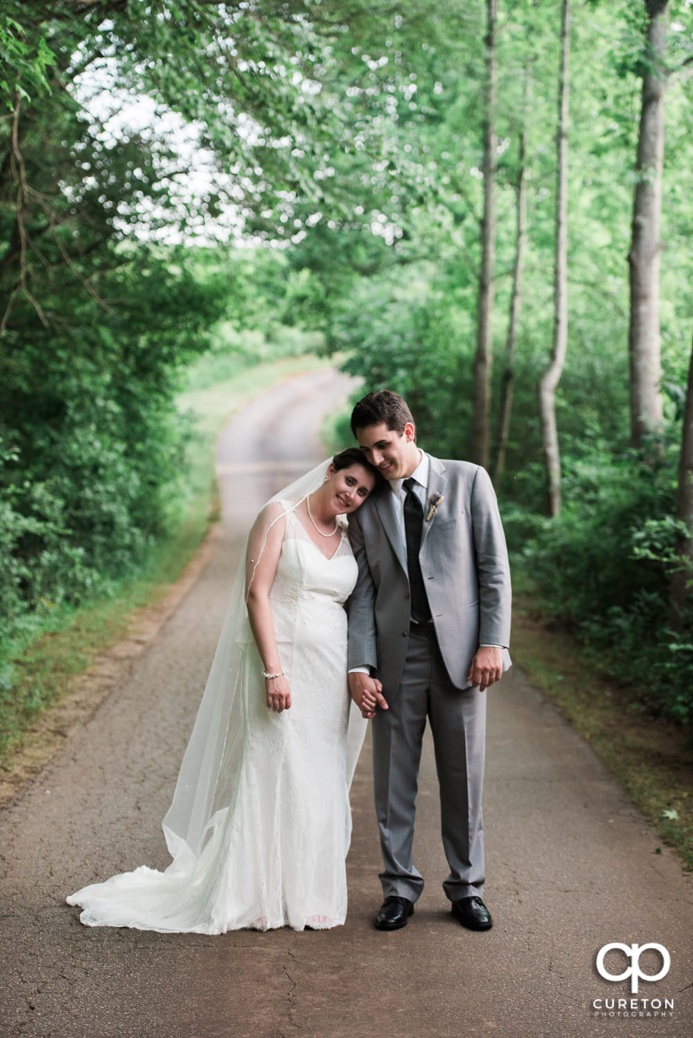 Bride and groom walking down the road at Greenbrier Farms.