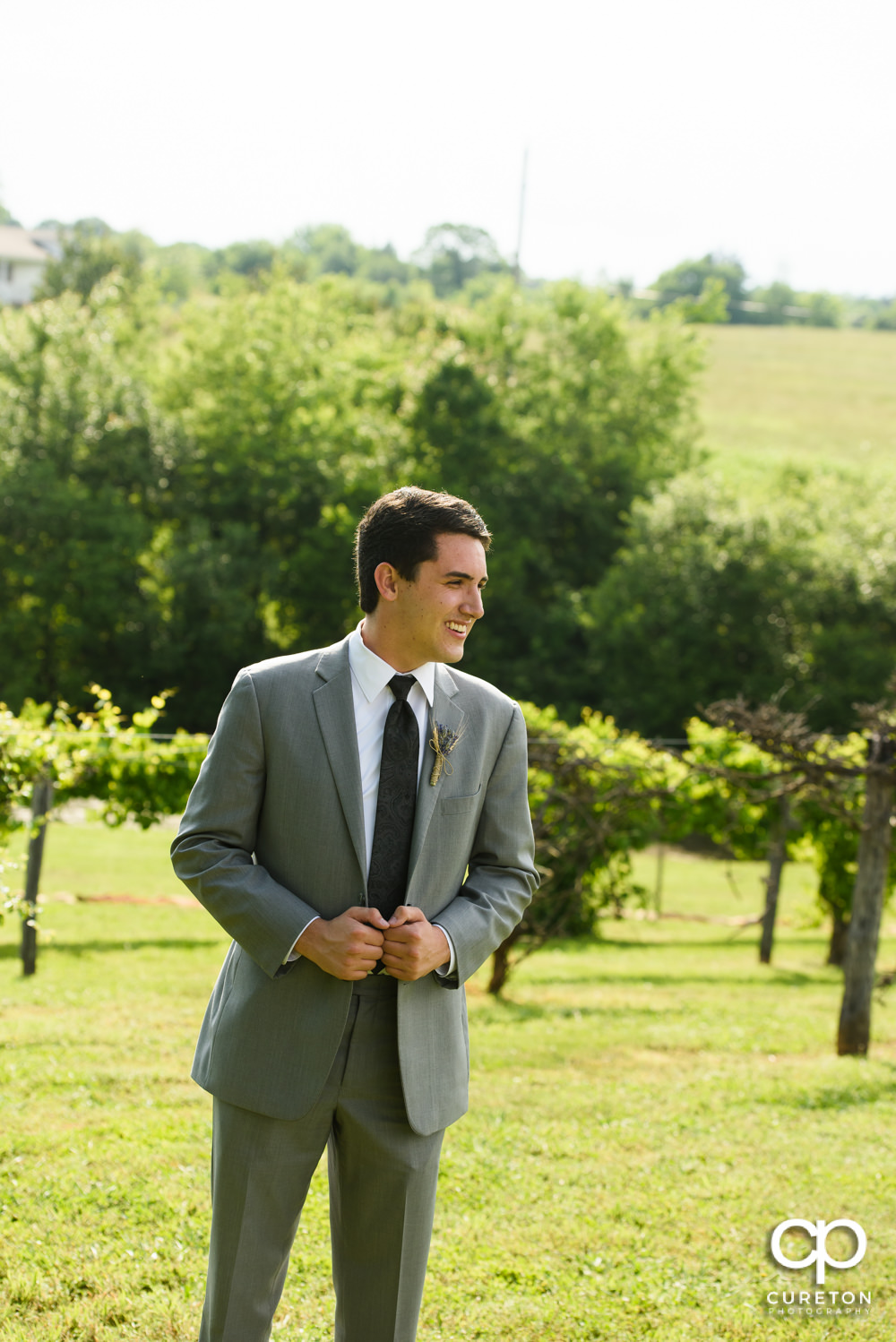 Groom standing in the vineyard at Greenbrier Farms.