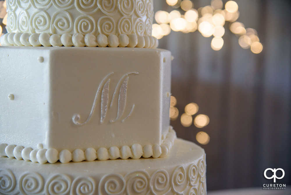 Closeup of a wedding cake.