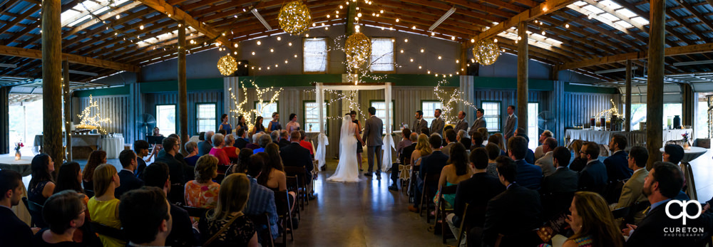 Pano of a wedding indoors at Greenbrier Farms.
